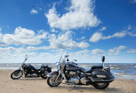 Two motorcycles on the bank of Baltic sea.