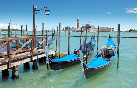 Two gondolas on the San Marco canal and Church of San Giorgio Maggiore in Venice, Italia. Stock Photo - 7579798