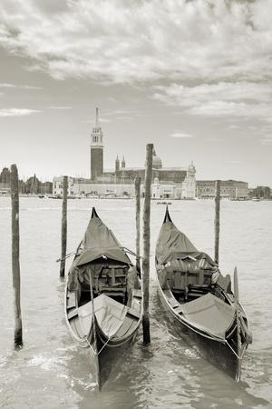 Two gondolas on the San Marco canal and Church of San Giorgio Maggiore in Venice, Italy. photo