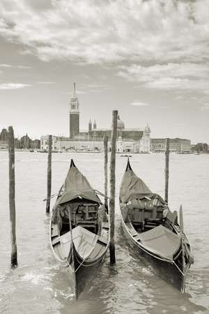 maggiore: Two gondolas on the San Marco canal and Church of San Giorgio Maggiore in Venice, Italy.
