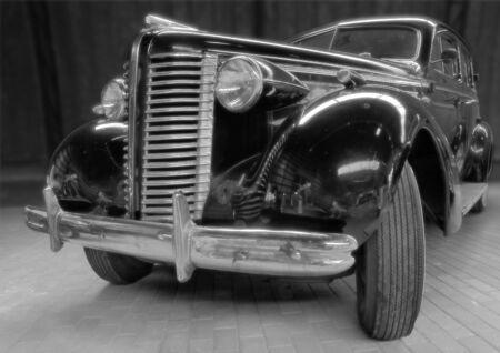antiquarian: The antiquarian car in garage.