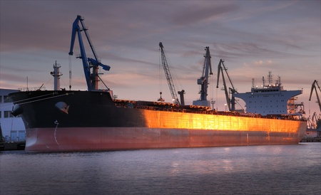 waterline: The ship under loading in Riga seaport, Latvia. Stock Photo