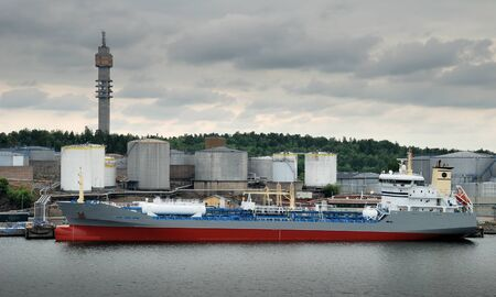 Ship is loaded by chemicals in port Frihamnsterminalen, Stockholm, Sweden.  photo