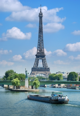 The Eiffel Tower, Seine river and Statue of Liberty in Paris, France.