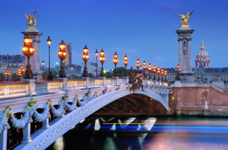 paris at night: The Alexander III Bridge across river Seine in Paris, France. Stock Photo
