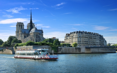 The passenger ship on river Seine near to island Cite in Paris, France.