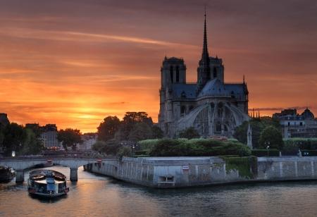 cite: Cathedral Notre Dame de Paris and bridge Pont de lArcheveche on island Cite in Paris, France.