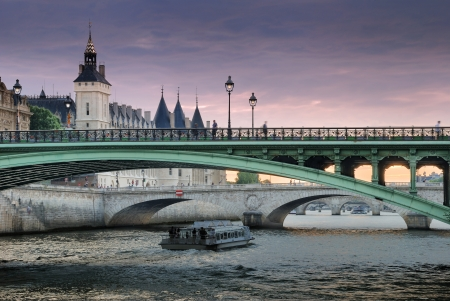 The bridge Pont Notre-Dame over river Seine in Paris, France.  photo