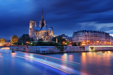 paris at night: Panorama of the island Cite with cathedral Notre Dame de Paris in Paris, France.