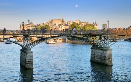 The bridge Pont des Arts or Passerelle des Arts across river Seine in Paris, France  Stock Photo