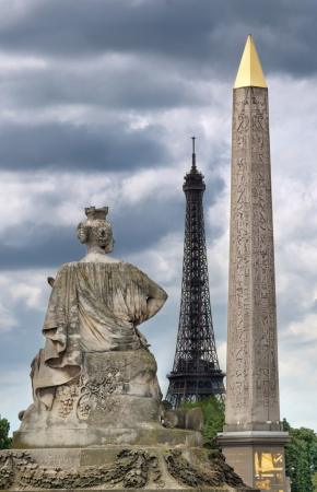 The statue representing the French city of Strasbourg, Eiffel Tower and Luxor Obelisk on the Place de La Concorde in Paris, France.  photo