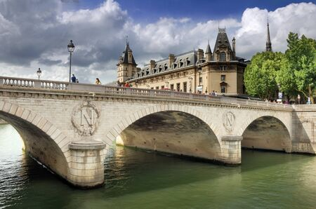 The bridge Pont au Change over river Seine in Paris, France. Stock Photo - 16615603