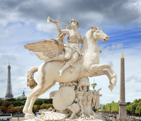 The statue of Renommee, or the fame of the king, riding the horse Pegasus (by Antoine Coysevox) at the west entrance of the Tuileries Garden in Paris, France. Stock Photo - 16978160