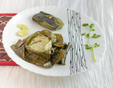 bengali: Fish Paturi is considered a delicacy in Bengali cuisine. The fish is seasoned with mustard sauce ,wrapped in banana leaves and steamed.