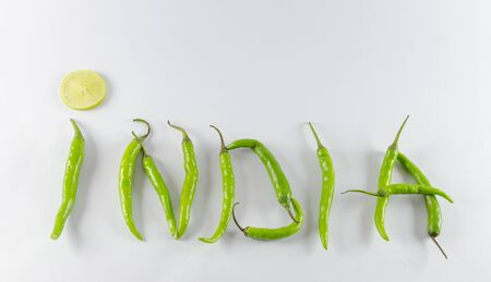 signifies: Green chillies are used in most Indian dishes. This signifies the hot and spicy Indian food. Stock Photo