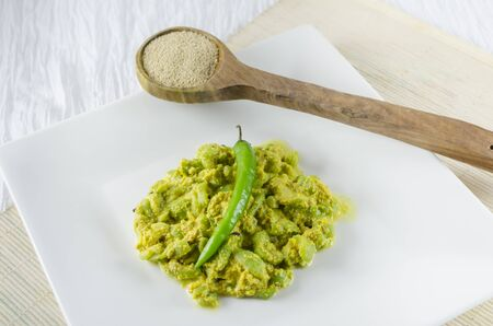 poppy seed: Ridge Gourd cooked with paste of poppy seed. It is a  very popular Bengali dish.