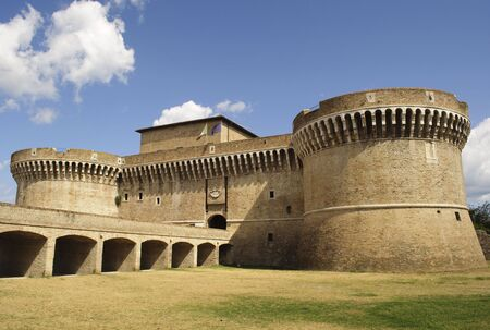 Fortress Rocca Roveresca in Senigallia, Italy on blue sky and puffy clouds background Archivio Fotografico
