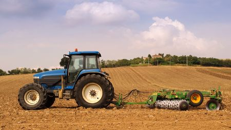 Tractor and farm in the background Stock Photo - 5556803