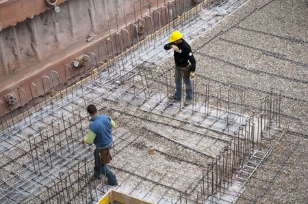 Construction workers working on a construction site