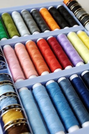 Sewing kit with colored spools of threads Stock Photo