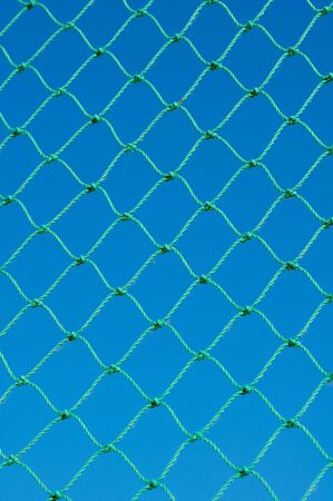 Green net on blue sky background  photo