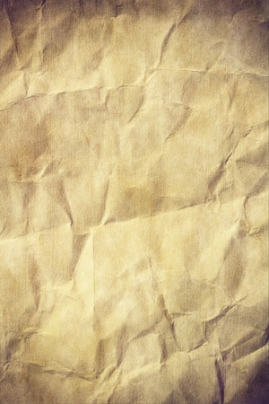 Aged crumpled paper with space for text or image photo
