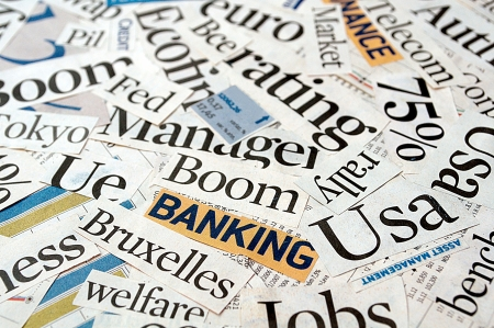 Newspaper and magazine headlines with financial terms and concept photo