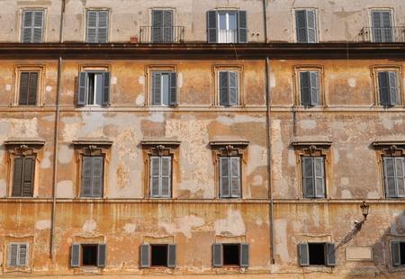 decorative balconies: Old building facade with windows in row