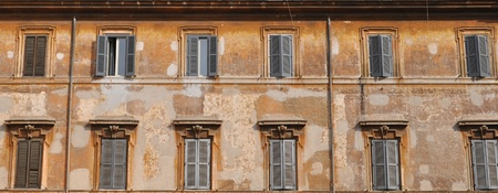old building facade: Windows in row on old building facade