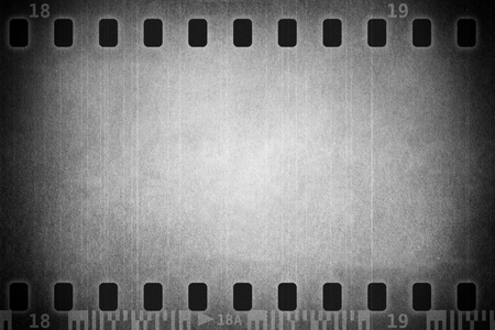 POSITIVE NEGATIVE: Grunge film background with space for text or image