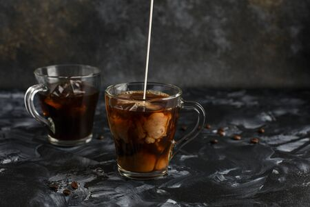Two transparent cups of cold coffee with milk. Iced coffee. Stok Fotoğraf