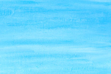 Textured blue background with white streaks. White stripes on blue painted backdrop. The background resembles the sky or the sea.