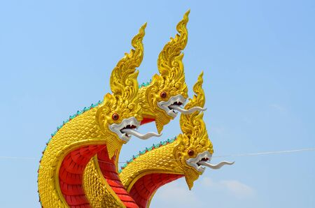 a legend of magic: Dragon guard statue at the temple entrance in Suphan Buri,Thailand
