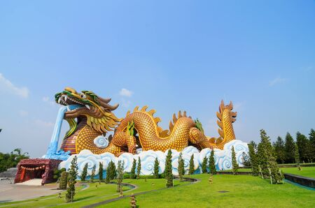 wat: Dragon guard statue at the temple entrance in Suphan Buri,Thailand