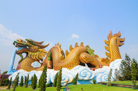 legends folklore: Dragon guard statue at the temple entrance in Suphan Buri,Thailand