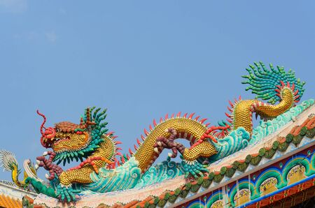Dragon guard statue at the temple entrance in Suphan Buri,Thailand photo