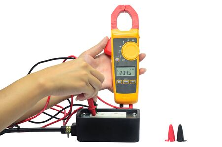 fusebox: Digital volt meter for Engineering Electrician at work. Stock Photo