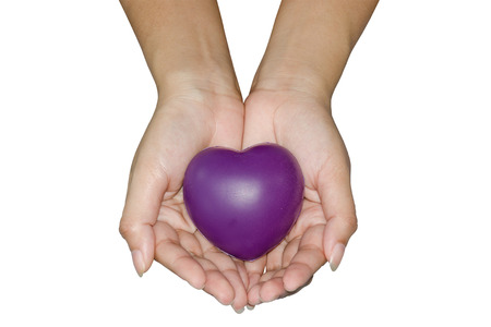 take care: Take care of Heart - Young female hand giving a heart to every people.