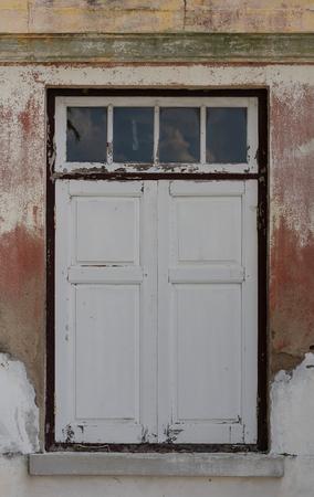 run down: Window of an old, run down building.