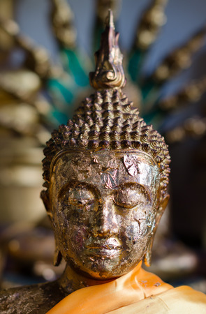 An old statue of Buddha, made of copper. Note for the inspector: the original artwork is done from monksartists in Thailand, this statue is part of the temple-complex and it is public domain.