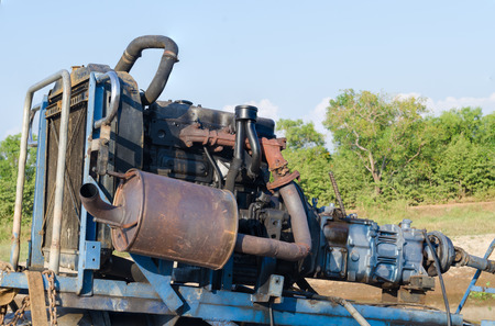 dumps: Large pump dumps water into an irrigation canal in the Central Valley. in Thailand.