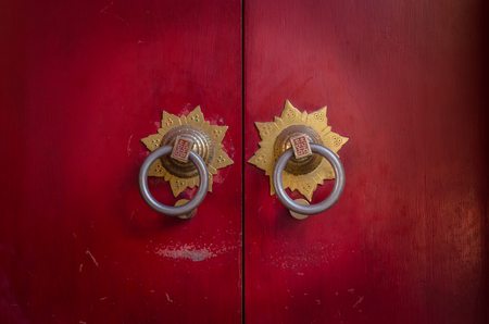 and antique: Traditional Chinese doors and door knockers, often found in old temples in China.