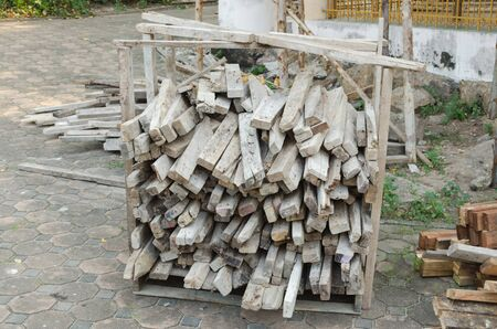 lumbering: Pile of tree trunks, Lumber pile at construction site wasted wood material for recycling.