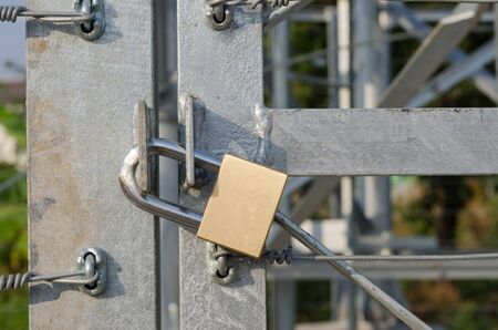 private security: steel door of warehouse is lock with Locked brass keys.