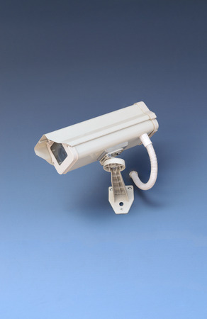security safety: Security CCTV camera in office building on blue background. Stock Photo