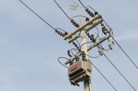 amp tower: High-voltage substation on blue sky background.