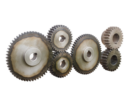 interlock: A huge set of rusty metal gears isolated on white.