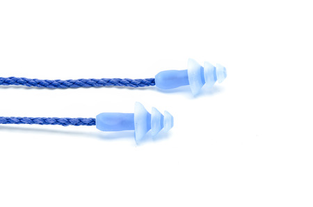 to muffle: Blue earplugs to reduce noise on a white background. Stock Photo