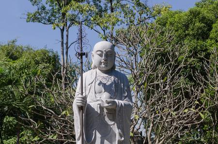 body consciousness: Xuanzang buddha Chinese priest on nature background. Stock Photo