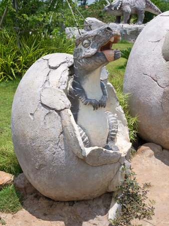 Dinosaur statue in theme park Stock Photo